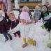 Zabawy z chustą, zapoznanie z instrumentami muzycznymi oraz zabawy na śniegu